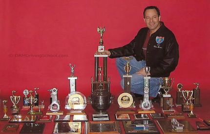 Dellis with Racing Trophies